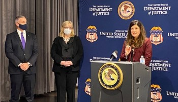 Dr. Colbert speaking at Department of Justice press conference