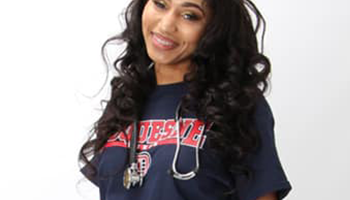 Diverse woman nursing student posing for camera with stethoscope around her neck