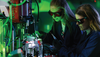 two woman students working in a science lab